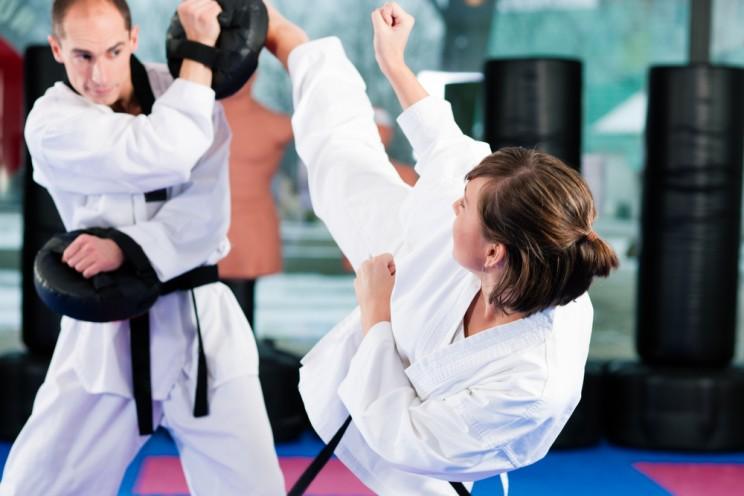 Training exercising Taekwondo, both have a black belt